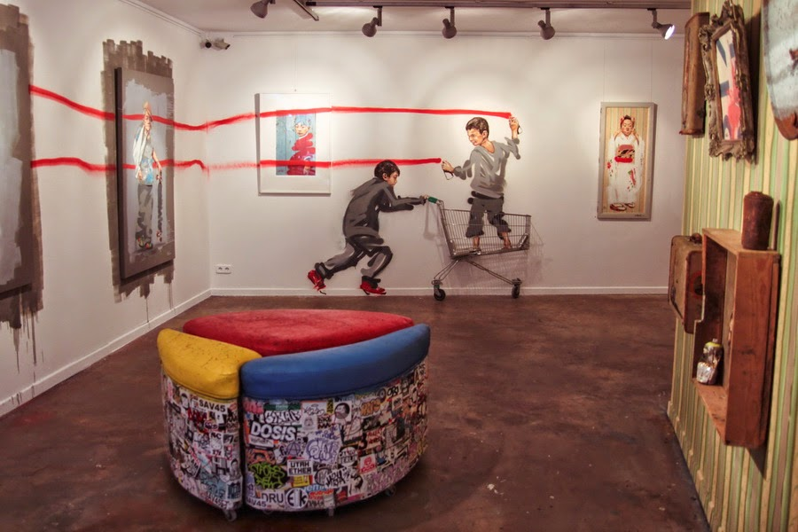 """While you discovered Ernest Zacharevic's latest street pieces in Barcelona (covered), the young Lithuanian artists was finishing up painting, installing and setting up the new works for his solo show """"Rock Paper Scissors!"""" @ Montana Gallery in Barcelona."""