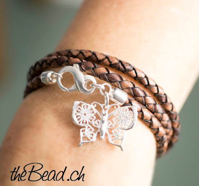 https://www.thebead.ch/product_info.php?info=p2319_butterfly-damenarmband-mit-schmetterlings-anhaenger.html