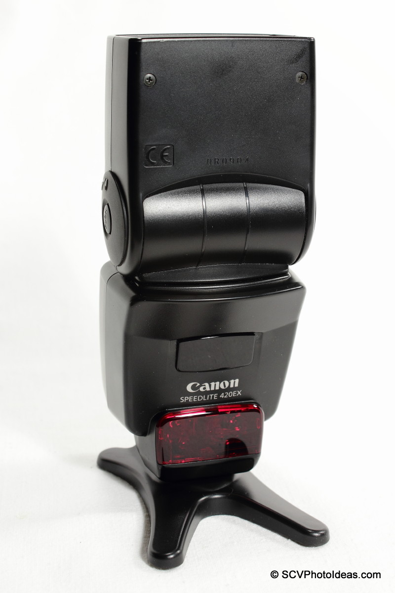 Canon Speedlite 420EX flash on foot stand