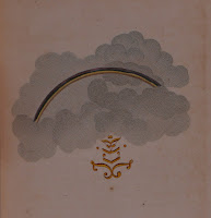 An emblem including clouds.