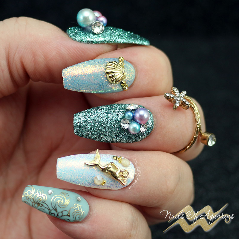 Created with: ibd Just Gel Polish Calm Oasis, Madam Glam Perfect White, Moyra Foil Polish for Stamping, Daily Charme Mermaid Tears Glitter Dust, Daily Charme Dreamy Mermaid Pearls, Moyra Magic Foil, Moyra Ornaments 03