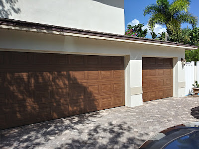 two car and one car garage doors painted to look like wood