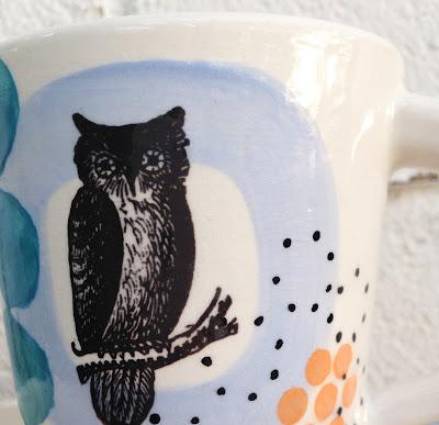 detail of owl on ceramic mug