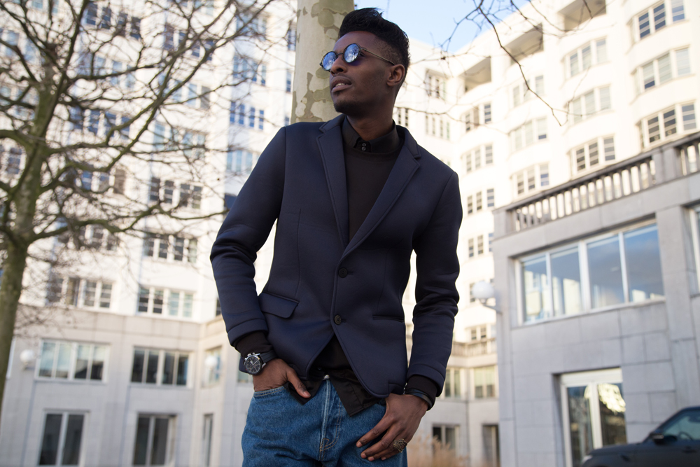 JON THE GOLD | ICONIC 501 | Levi's 501ct customized and tapered - Jonathan is wearing native youth jacket , WE FASHION neoprene blazer, SECTION STORE sweater, MEXX shirt, 501 ct levis jeans , lord eston dress shoes oris watch freyrs sunglasses antwerp streetstyle - Jonathan Zegbe Menswear blogger and founder of JON THE GOLD BLOG