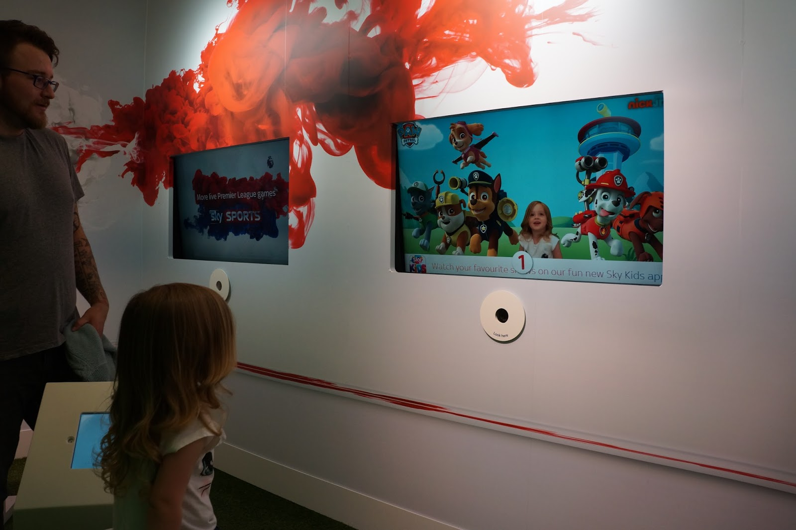 toddler looking at an image of themselves with cartoons at sky studios