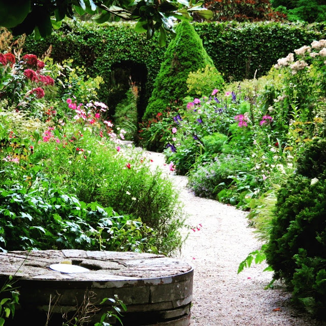 Walled Garden and millstone at Mount Usher Gardens in County Wicklow