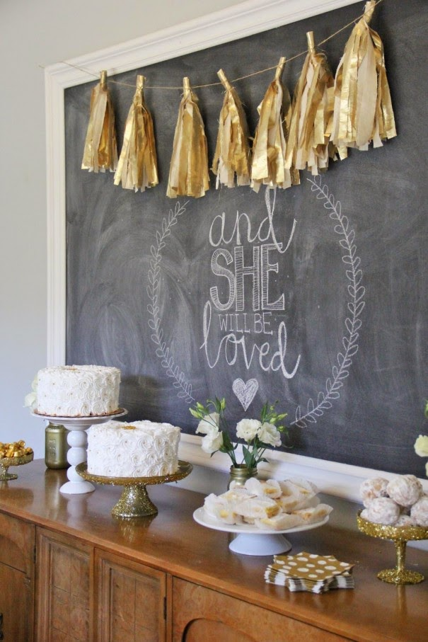 dessert table white and gold, with tassel garland and cute background