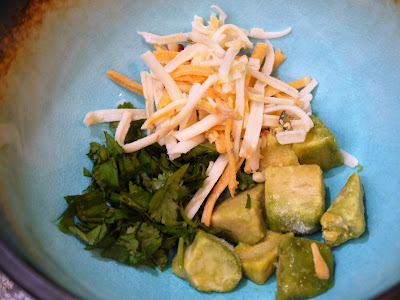garnishes - avocado, chopped cilantro and shredded cheese