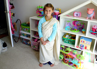 Tessa in our version of a Mesopotamian long robe.