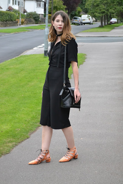 Womens affordable highstreet fashion blog featuring British street style. Topshop Black button down playsuit with cut out back. orange snake skin lace mid heel shoes from ASOS. Black suede and leather and Topshop