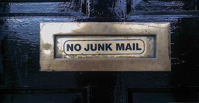 """black door with metal letter slot that says """"no junk mail"""""""