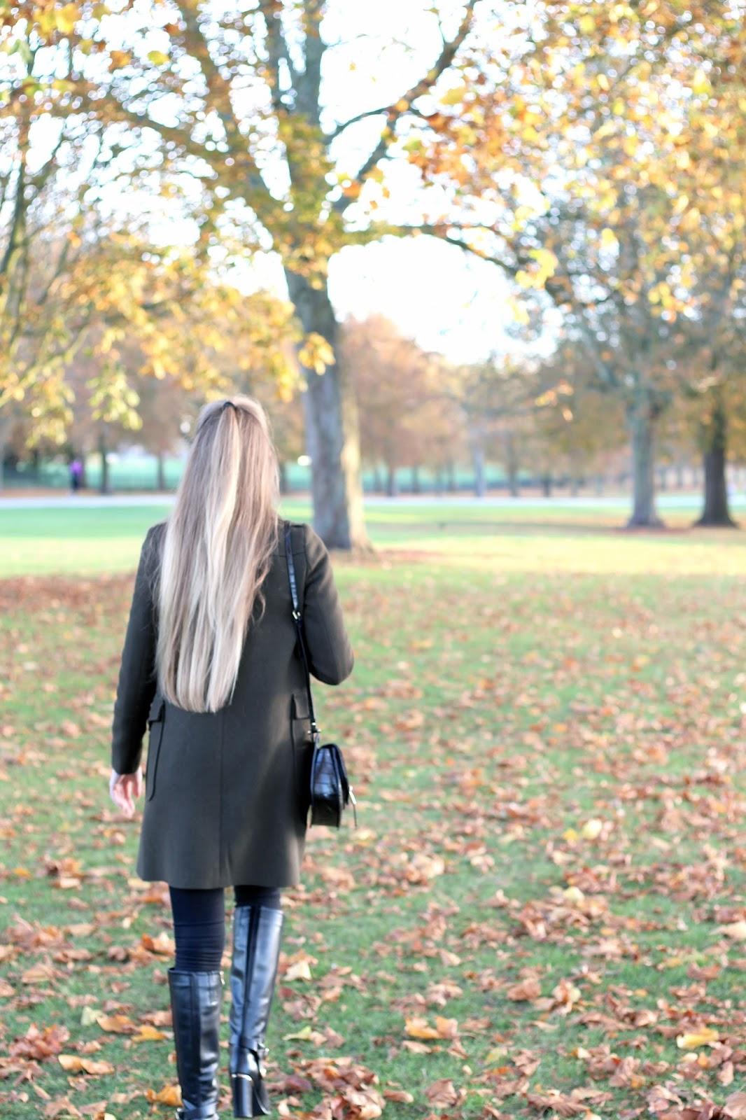 Long blonde hair Autumnal scene orange leaves