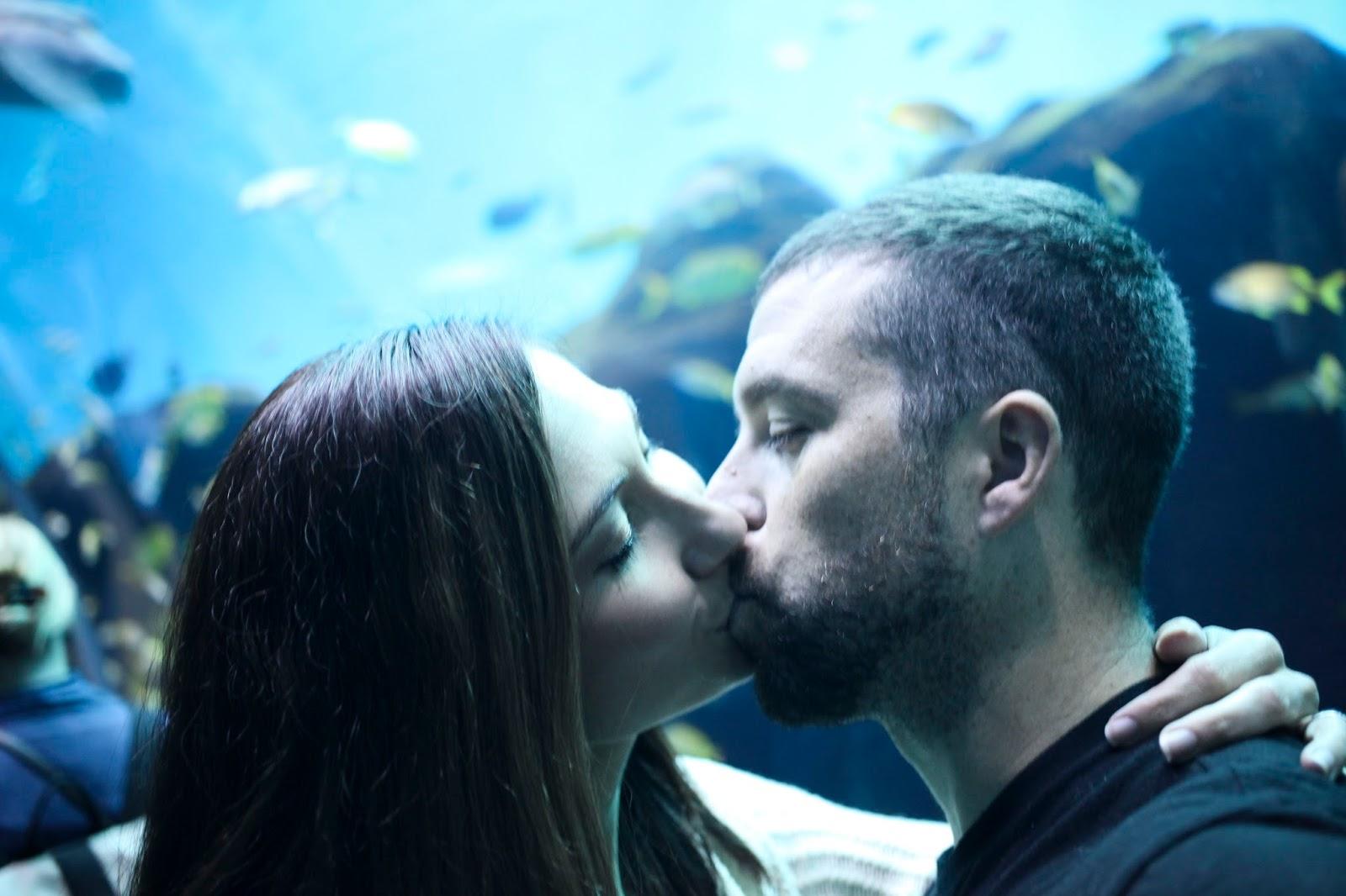 a stolen kiss in an under water world at the Georgia Aquarium