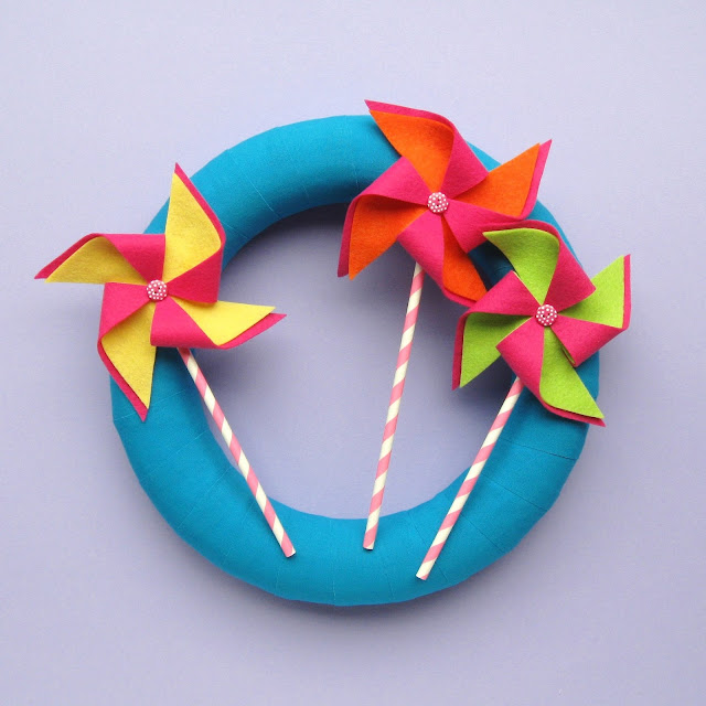 https://www.thevillagehaberdashery.co.uk/blog/2017/a-year-of-wreaths-july-felt-pinwheels-wreath-by-laura-howard