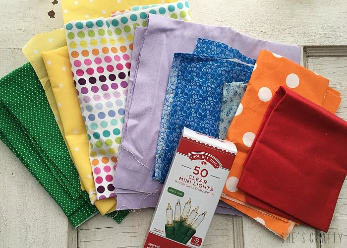 Supplies needed to make a DIY lighted rainbow fabric banner