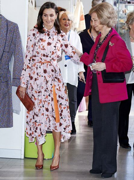 Queen Letizia wore a new floral print midi shirtdress by Hugo Boss at charity market Rastrillo Nuevo Futuro. Queen Sofia