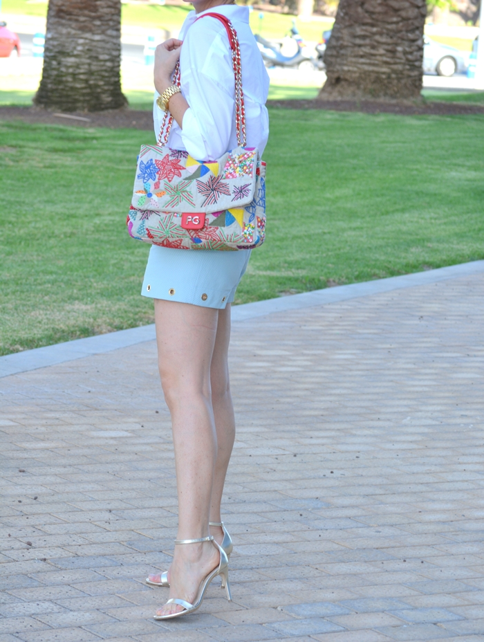 blue-shorts-aurelia-gil-golden-heeled-sandals