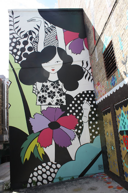 Vibrant street art stands out at Black Cat Alley in Milwaukee