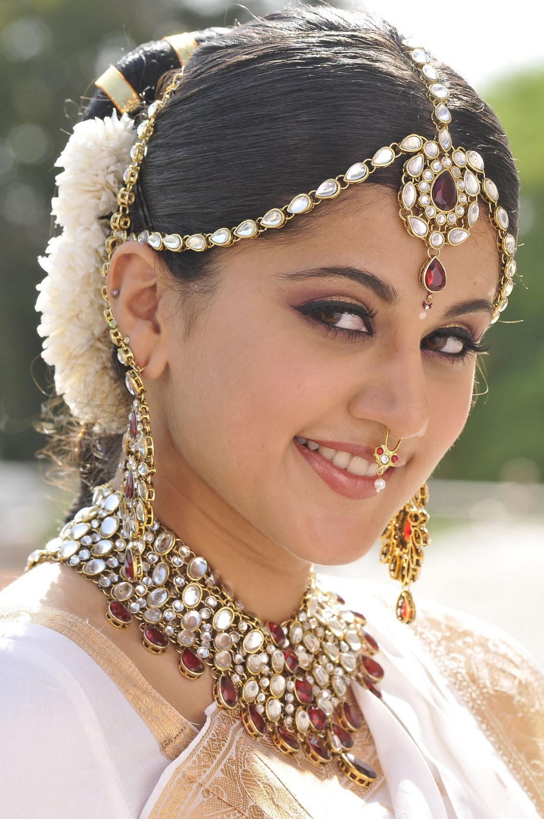 very cute actress taapsi in bridal and traditional style