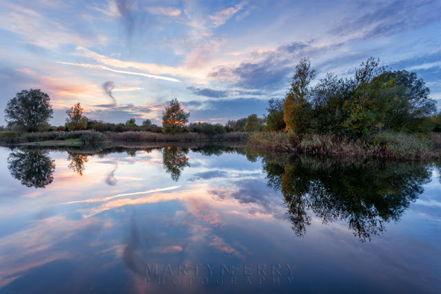 Gentle river at dusk in the Ouse Fens Nature Reserve in Cambridgeshire