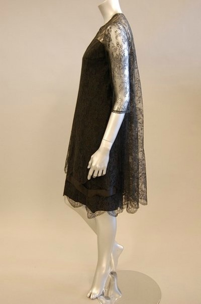 Black chantilly lace cocktail dress on mannequin for Castillo Paris 1962-1963