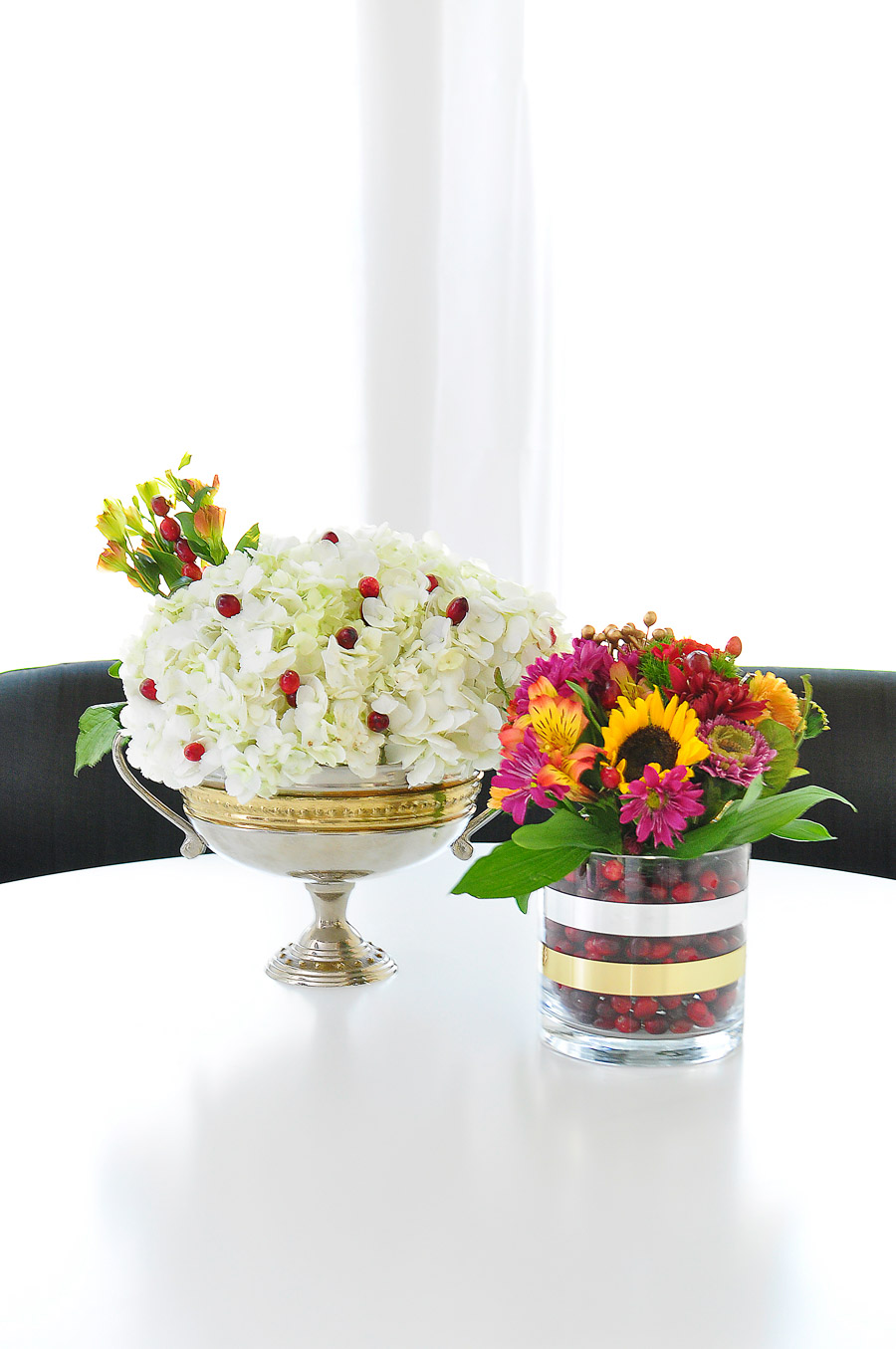 These simple floral and cranberry centerpieces will add a touch of elegance to any holiday tablescape.