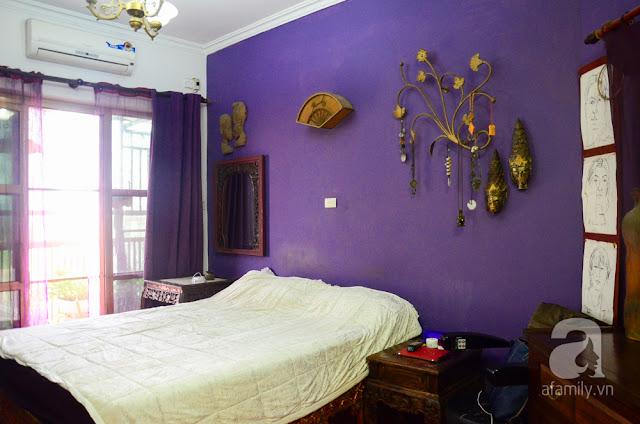 Phòng ngủ master với tone màu tím pha chút phong cách hiện đại.