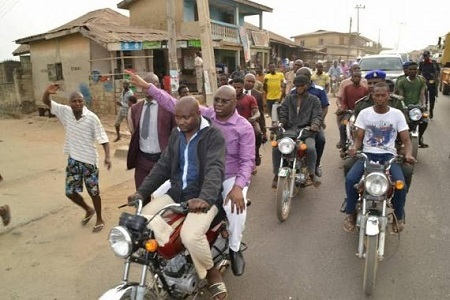Wow! See Gov. Fayose Riding on Okada As He Inspects Newly-installed Water Taps in Ekiti Community (Photos)