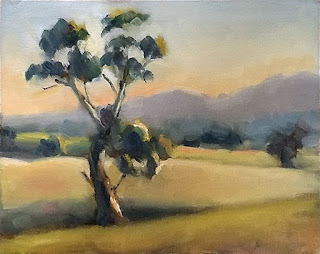 Landscape oil painting of a eucalypt with distant hills.
