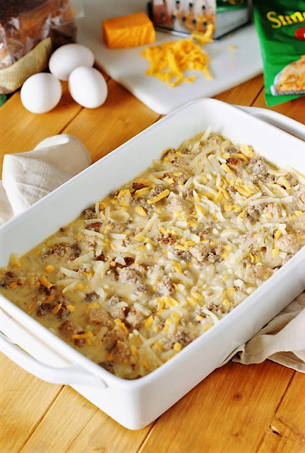 Preparing Overnight Sausage, Egg & Hash Brown Breakfast Casserole Image