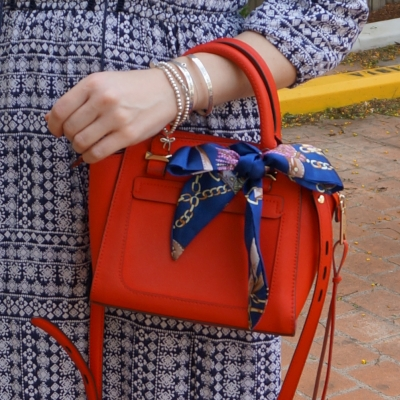 red rebecca minkoff micro avery bag with scarf tied in bow | away from the blue