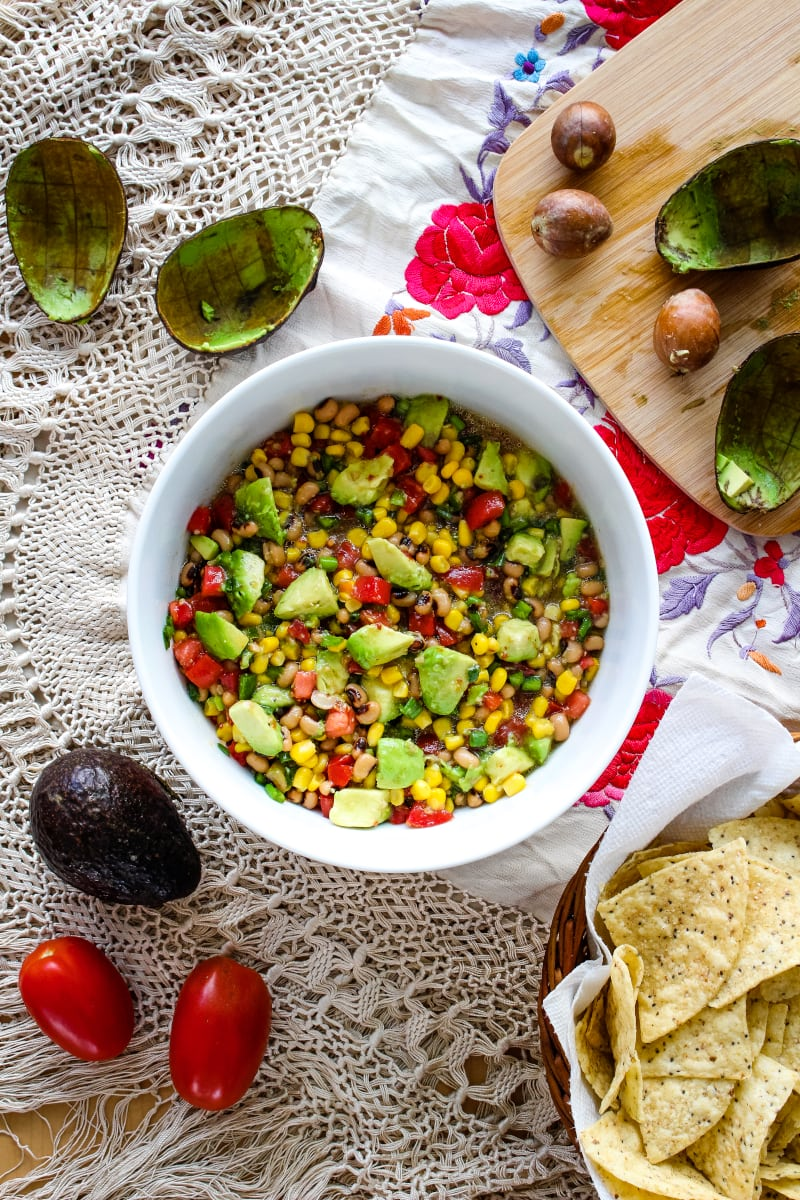 Avocado Texas Caviar is an easy to make appetizer that comes together in just minutes! It's perfect for parties and game day get-togethers! #appetizer #diprecipes #avocado