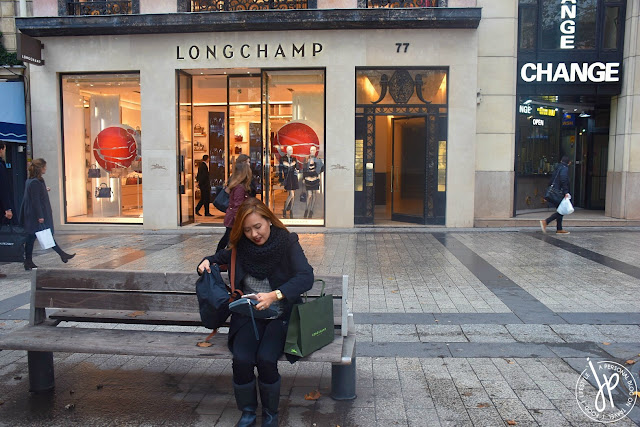 girl in bench, longchamp store