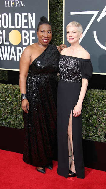 Tarana Burke, Social Activist and founder of the #MeToo (2006), Right: Michelle Williams, Actress at the 75th Annual Golden Globes