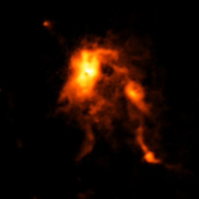 Protostar blazes and reshapes its stellar nursery