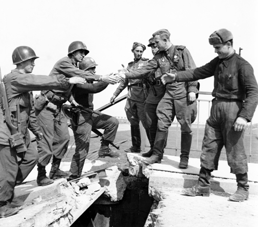 "The Link-Up. The ""Meeting at the Elbe"" River on Apr. 25, 1945 between the American 69th Infantry Division and the Soviet 58th Guards Division, Torgau , Germany. For a brief moment, the world was united against tyranny. Photo: The Fighting 69th Infantry Division Association"