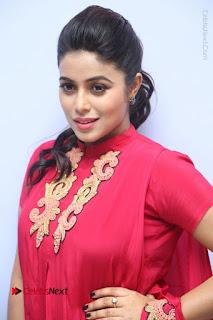Actress Poorna Latest Stills in Red Dress at Rakshasi First Look Launch  0019.JPG