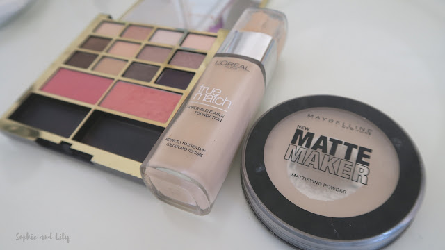Face base products; blusher by Estee Lauder, foundation by L'Oreal and powder by Maybelline