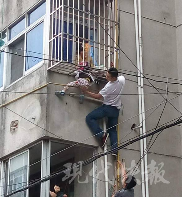 3-year-old boy rescued after getting head stuck in window bars (See Photos)