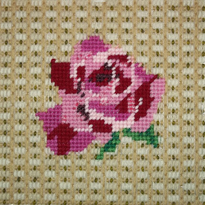 Rose needlepoint with bargello background