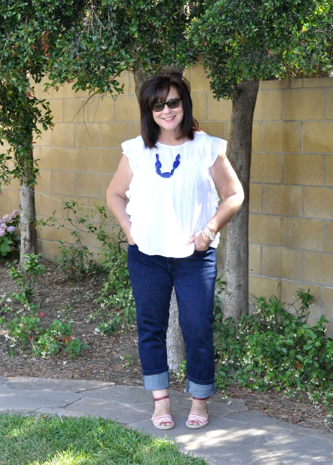 white ruffle top and cuffed blue jeans