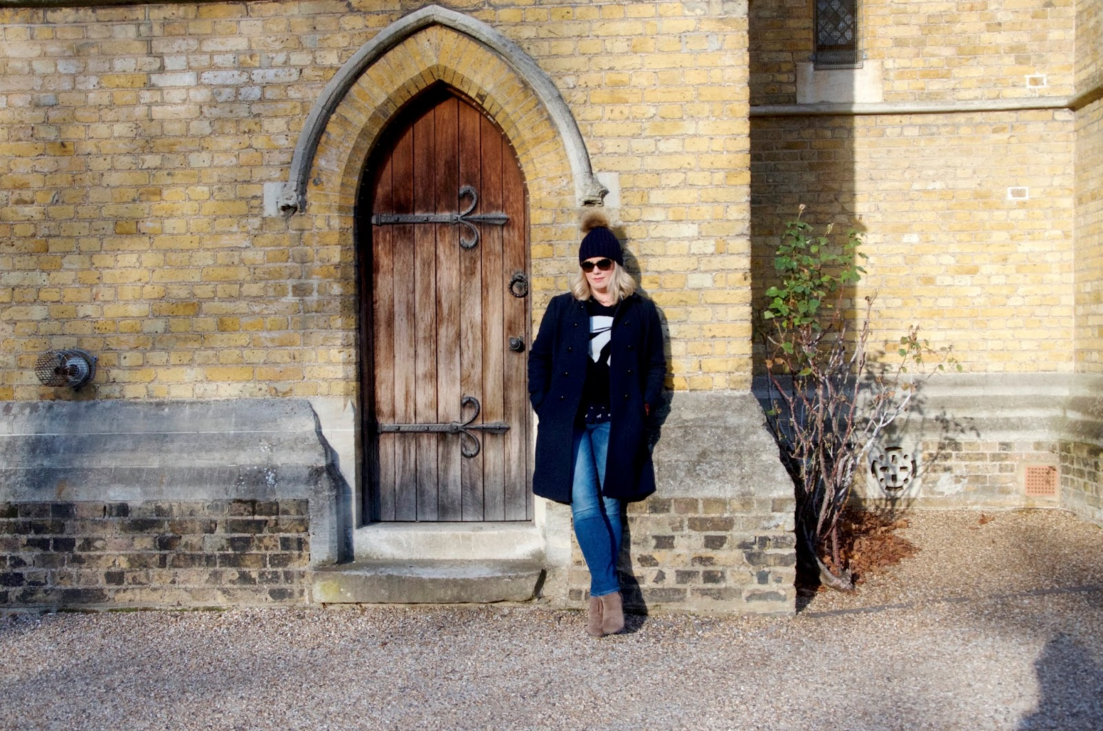 Church door, tree and navy blue coat