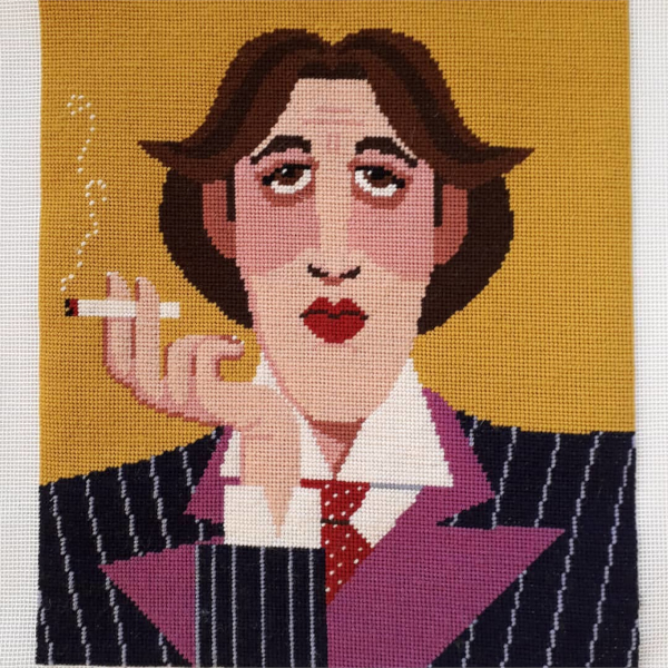 Oscar Wilde smoking a cigarette - needlepoint design by Emily Peacock