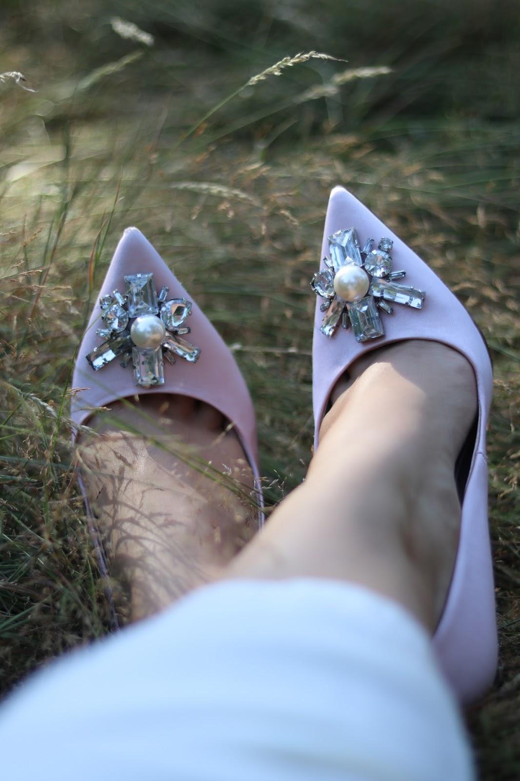 Katie Heath wearing ASOS Wedding Dress and satin pink bejewelled heels in Richmond Park, London