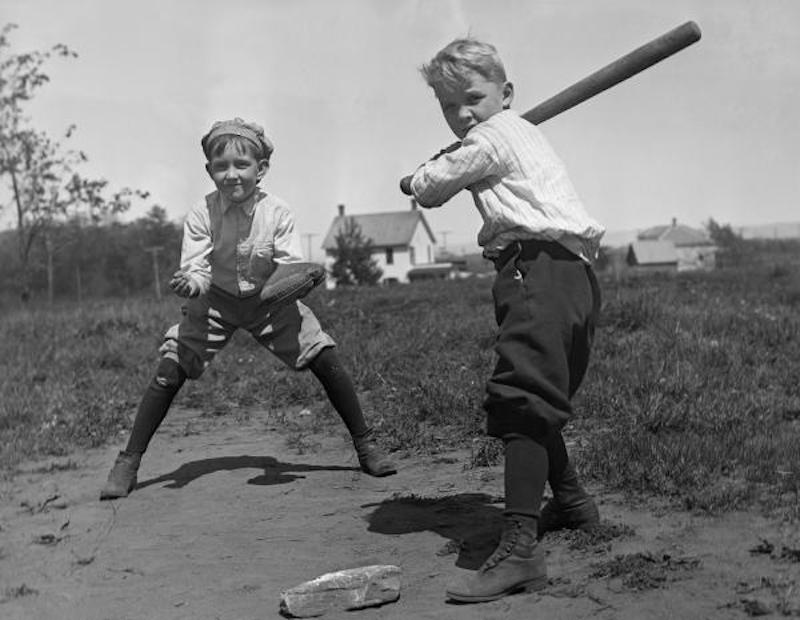Two young boys playing baseball c. 1910 Image from explorepahistory.com