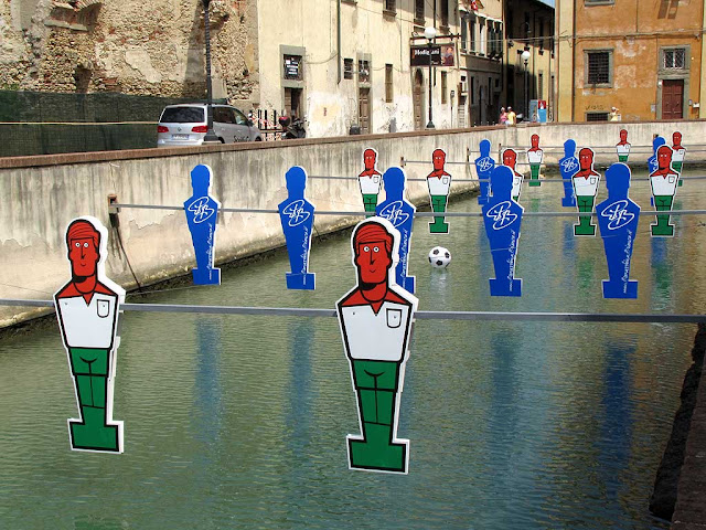 Giant table football in a canal, Livorno