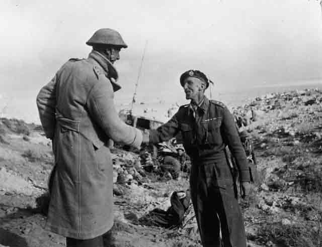 Celebratory handshake after relief of Tobruk garrison in North Africa, 27 November 1941 worldwartwo.filminspector.com