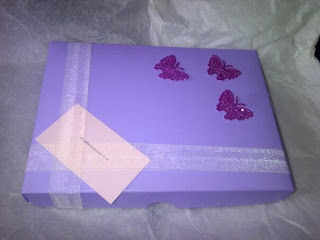 Chocolate by Genevie main box, decorated with butterflies but rather plain looking.