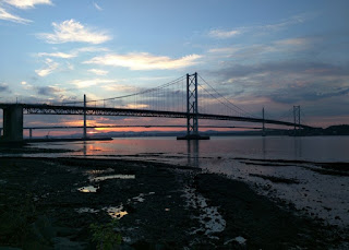 Road bridges across the Firth of Forth at sunset, South Queensferry, Scotland
