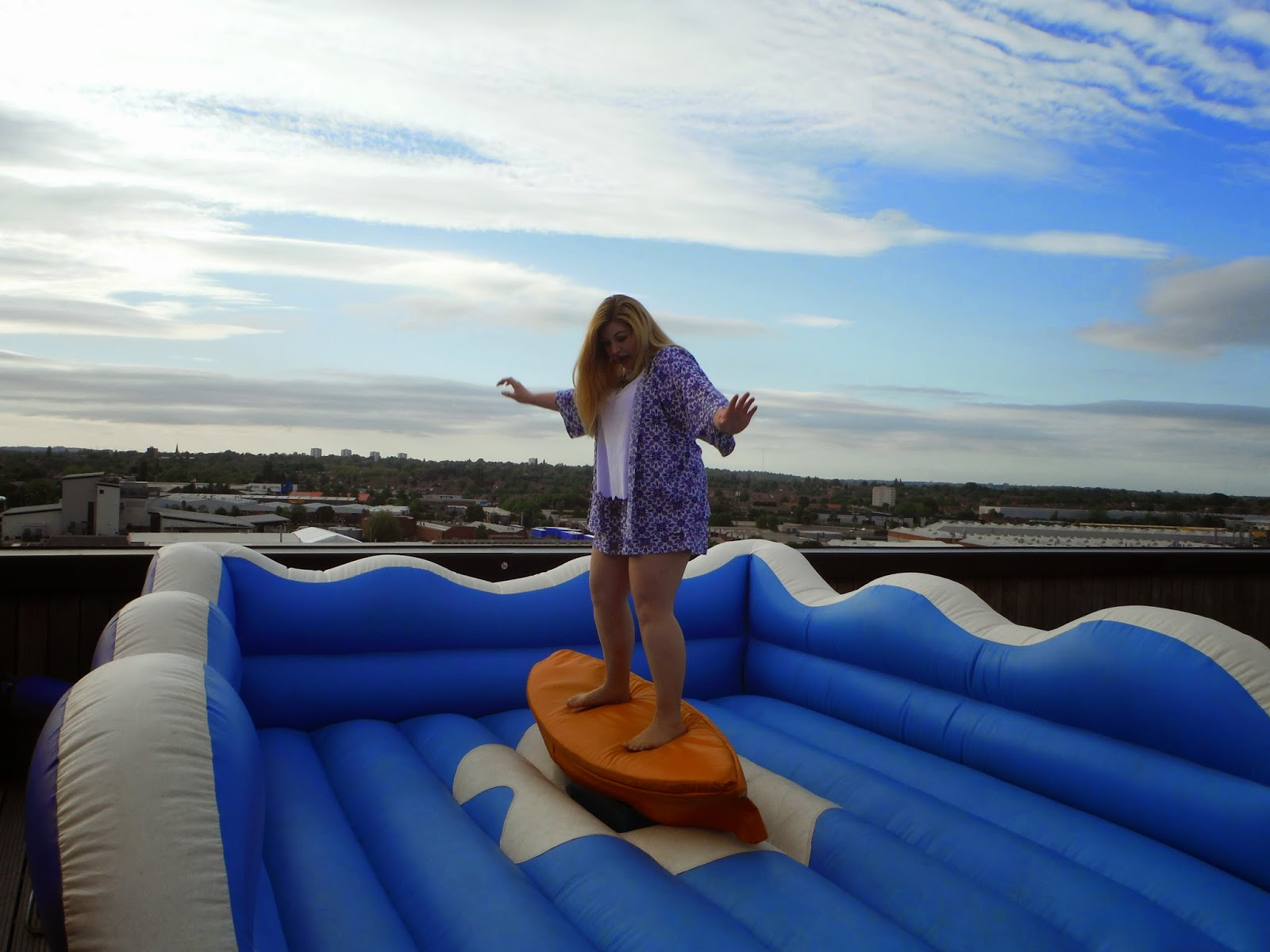 myself standing on the surfboard ride moments before I fell off